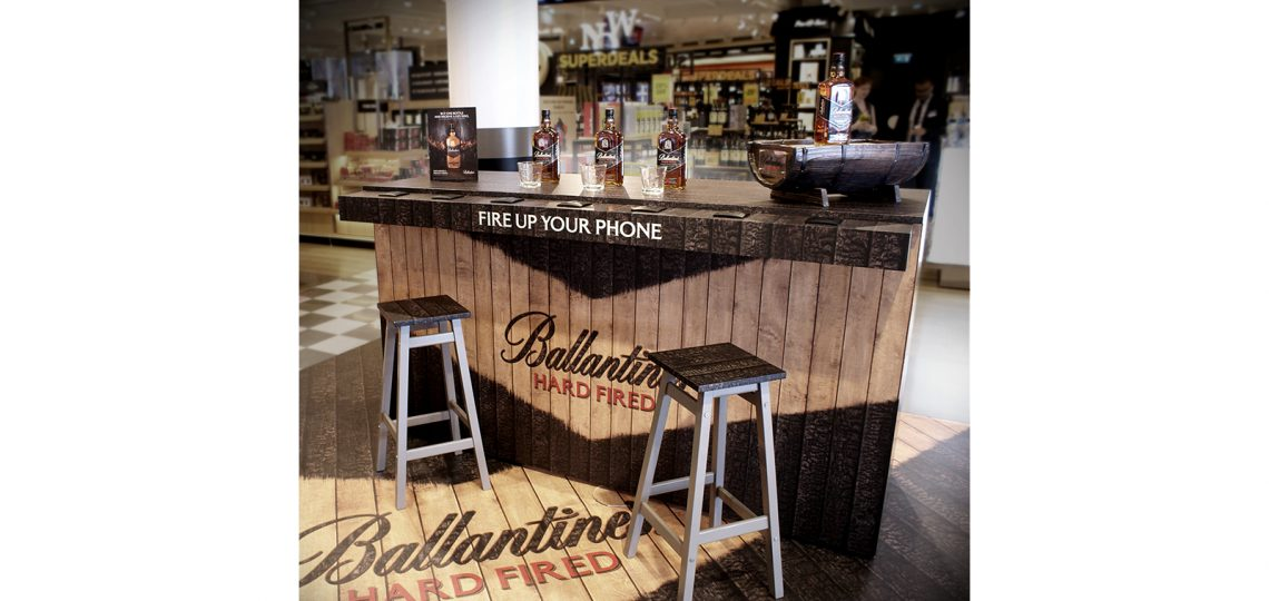 Ballantine's Hard Fired whisky variant – matured in charred American oak barrels – has introduced multisensory charred bars to Paris airports to highlight the bespoke distillation process. The Ballantine's Hard Fired multisensory bar will be a new engagement launching in the travel retail environment, giving passengers the opportunity to 'fire up' their journey with a taste of whisky while sitting at a bespoke charred bar, smelling hints of wood smoke and vanilla.